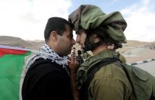 Abdallah Abu Rahma in front of an israeli military, 2014